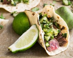 flank steak taco with tomatillo and avocado salsa